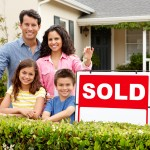 family-in-front-of-sold-sign-2